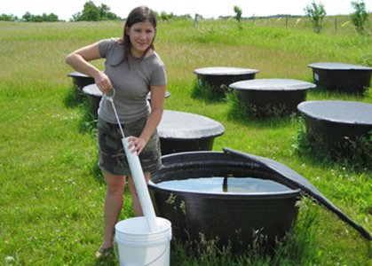 Student conducting mesocosm research