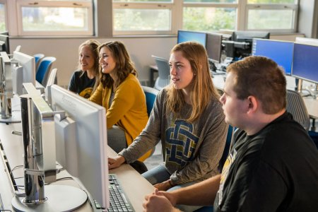 Students work in the First Dakota National Bank e-Trading Education Laboratory.
