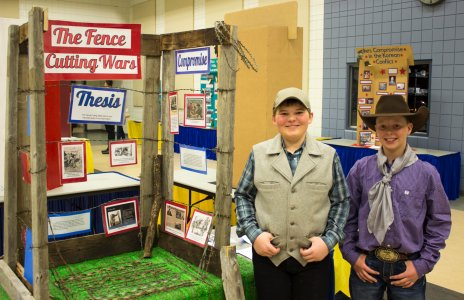 """NHD in SD Student's posing with their exhibit board titled 'The Fence Cutting Wars."""""""