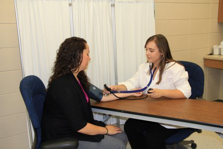 Student pharmacist conducting a blood pressure screening