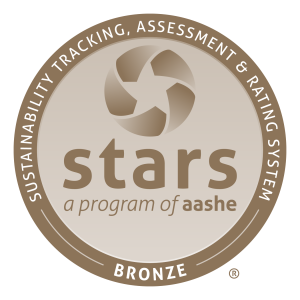 "STARS Bronze Logo - a brown ring with white lettering on the top that says ""Sustainability Tracking, Assessment & Rating System."" The bottom says Bronze. Inside the ring is a lighter brown and has the STARS star symbol and underneath it says, ""stars"" and below that it says ""a program of aashe."""