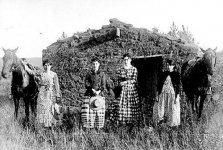 Women homesteaders in front of their sod house