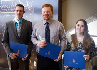2018 First Dakota National Bank New Venture Competition finalists - Nathan Lax, Logan Roth and Laurel Diekhoff.