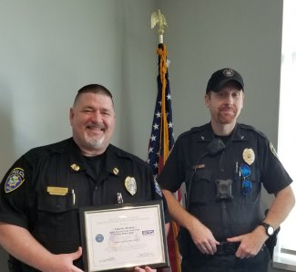 South Dakota State University Police Department Chief Tim Heaton, left, displays his Patriot Award. Marc Rieger, a corporal with UPD, nominated Heaton after being allowed to leave on a recent deployment.