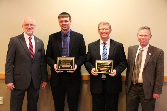 Department Head Van Kelley (left), Outstanding Alumni receipients Derek Heeren (second from left) and Kenneth Hellevang (second from right), and Dr. Don Marshall (right)