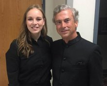 Julia Okerman stands next to Jerry Junkin, who conducted the Kappa Kappa Psi and Tau Beta Sigma National Intercollegiate Band.