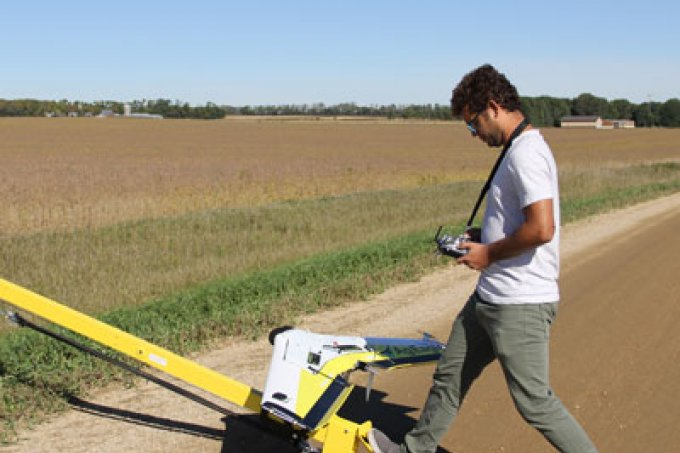 Deepak preparing to fly drone over soybean field