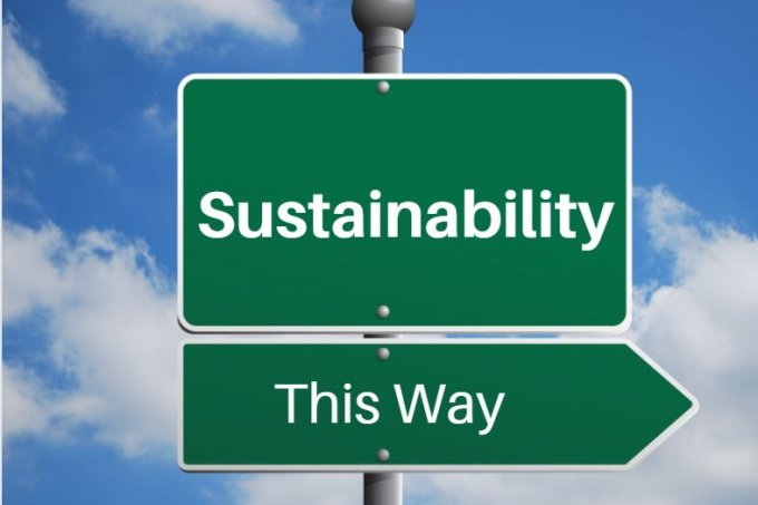 "Street sign that says ""Sustainability this way""."