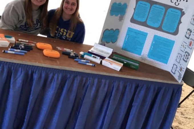 SDSU pharmacy students Abby Blanchette, left, and Ashley Bernardy, right, man the Operation Diabetes booth at the 2019 State Fair in Huron. Shown are various insulin administration devices, which was an additional feature by State's Student Collaboration for the Advancement and Promotion of Pharmacy chapter. The group won the regional Operation Diabetes award.