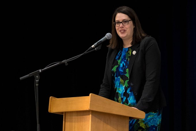 Rebecca Bott-Knutson, dean of the Van D. and Barbara B. Fishback Honors College, greets the audience at South Dakota State University's Undergraduate Research, Scholarship and Creative Activity Day, held April 9.