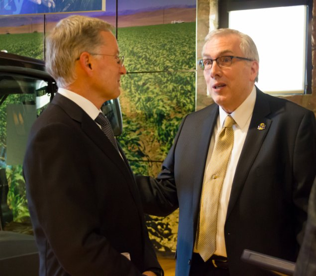 Raven President/CEO Dan Rykhus and SDSU President Barry Dunn talk after Raven's $5 million donation Jan. 9, 2018