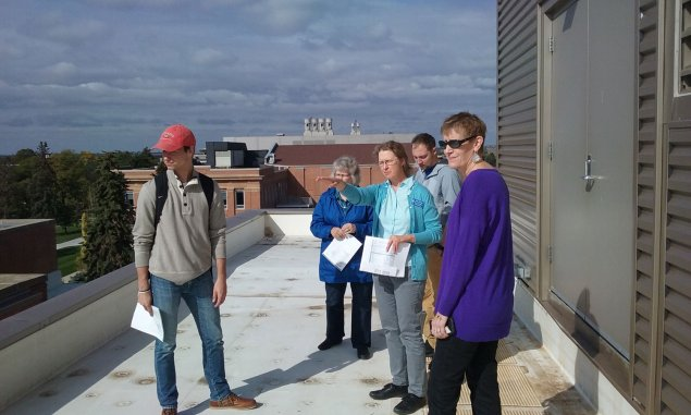 Faculty, staff, and students on the roof of AME during the campus sustainability tour.