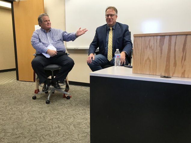Jay Huizenga and Dave Bordewyk discuss media economics with students in the Mass Media in Society class.