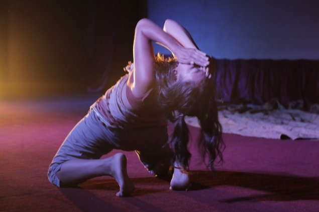 Dance, Leila Awadallah, kneeling with hands over her face looking skyward