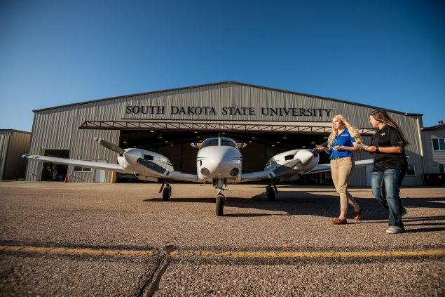 Student and CFI with plane