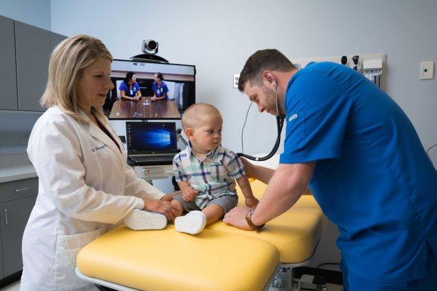 Male nurse with pediatric patient