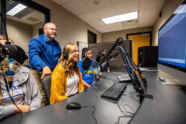 Doctor Dailey and students make a recording