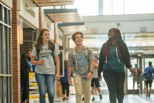 Three students walking down Main Street in the Student Union