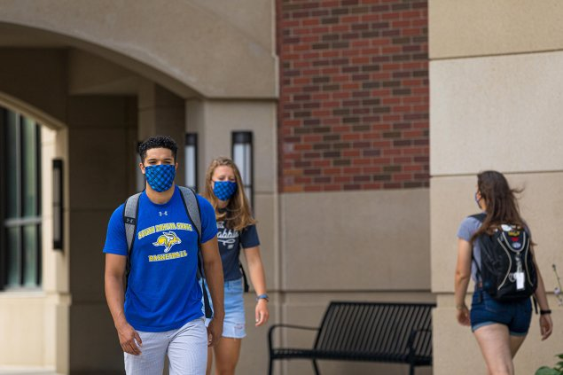 Students walking outside of Hyde Hall