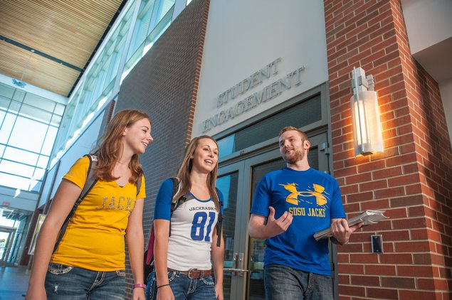 Students walking in front of Student Engagement Office