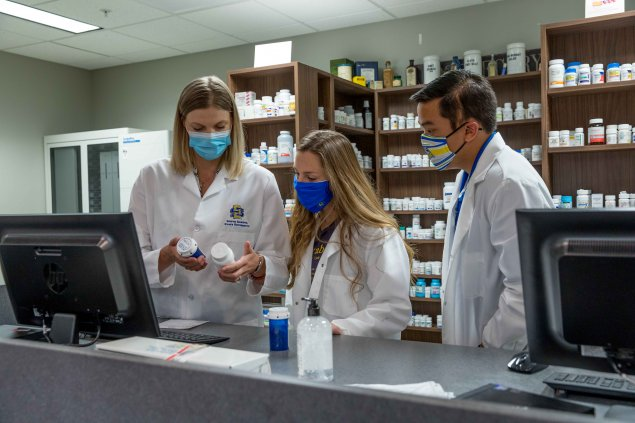 Pharmacy students in lab