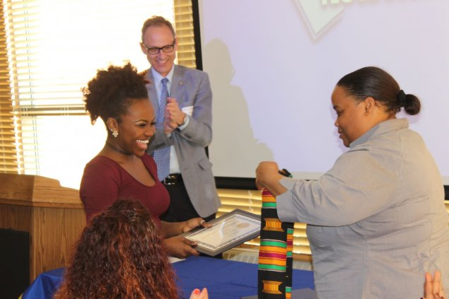 Director of the Office of Multicultural Affairs Ms. Kas Williams recognizing a student graduate.
