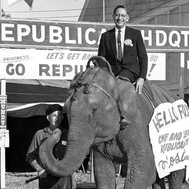 Ben Reifel sitting on an elephant at the South Dakota State Fair in Huron in 1960