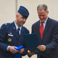 Gov. Dennis Daugaard receives an SDSU flag and certificate from Lt. Col. Craig McCuin, commander of Detachment 780 of the Air Force ROTC at SDSU, at Governor's Day in 2016. The flag was flown on a B-1 training mission by a former SDSU cadet who is now a pilot at Ellsworth Air Force Base, Rapid City. This year's Governor's Day is 1 p.m. April 26 on Sylvan Green on the South Dakota State University campus.