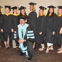 Stephen Saiz, kneeling, liaison for South Dakota State University Counseling and Human Development program in Rapid City, poses with the spring graduates at their April 30 hooding. Pictured, from left, are Maria Hartung, Jacquelyn Galles and Megan Laskowsi, all of Rapid City; Jennifer Bristow, Pierre; Bobbi White, Porcupine; Wiletta Woodson, Rapid City; Kelsey Soles, Tara Silvernail, Rapid City; Jonna Langston, Lusk, Wyoming; and Jennifer Edwards, Rapid City.