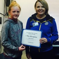 "Emma Smith, a fifth-grader at Hermosa Elementary School, receives a certificate from LeAnn Lamb, an instructor with the West River Nursing Department. Smith was winner of South Dakota State University's 16th annual ""Why I Want to be a Nurse"" essay contest."