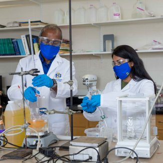 Muthu and graduate student making epoxidized soybean oil