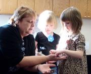 Teacher interacting with children